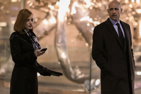 Jessica Chastain and Mark Strong in Miss Sloane
