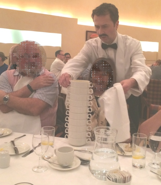 Manuel has a most likely foolproof method of clearing the table between courses.
