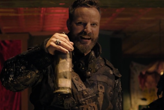 What the well-dressed afterscape warlord wears: distressed leather and vintage buckles, accessorized with the last bottle of bourbon in existence.