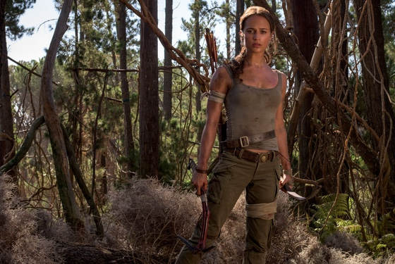 Lara wears our Perfect Tank in morose (£495); Adventurer's Trousers in grim (£1,975); axe, belt, bandages her own.