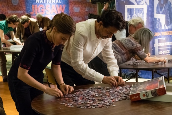 Strategy is actually involved in competitive jigsaw puzzling, and it involves -- among other things -- standing up to puzzle.