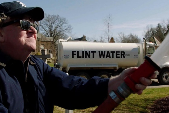 Moore hoses down the Michigan governor's mansion with Flint's poisoned municipal water. Now that's a protest.